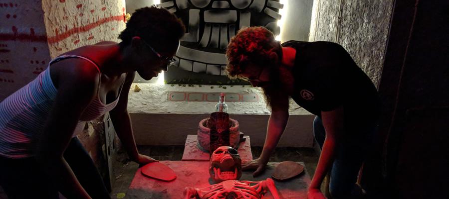Escape room players in the Mayan escape room